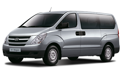 Silver Hyundai H-1 Station Wagon. Minivan for car rental.